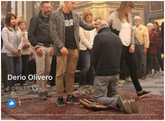 bishop kneels for lay blessing